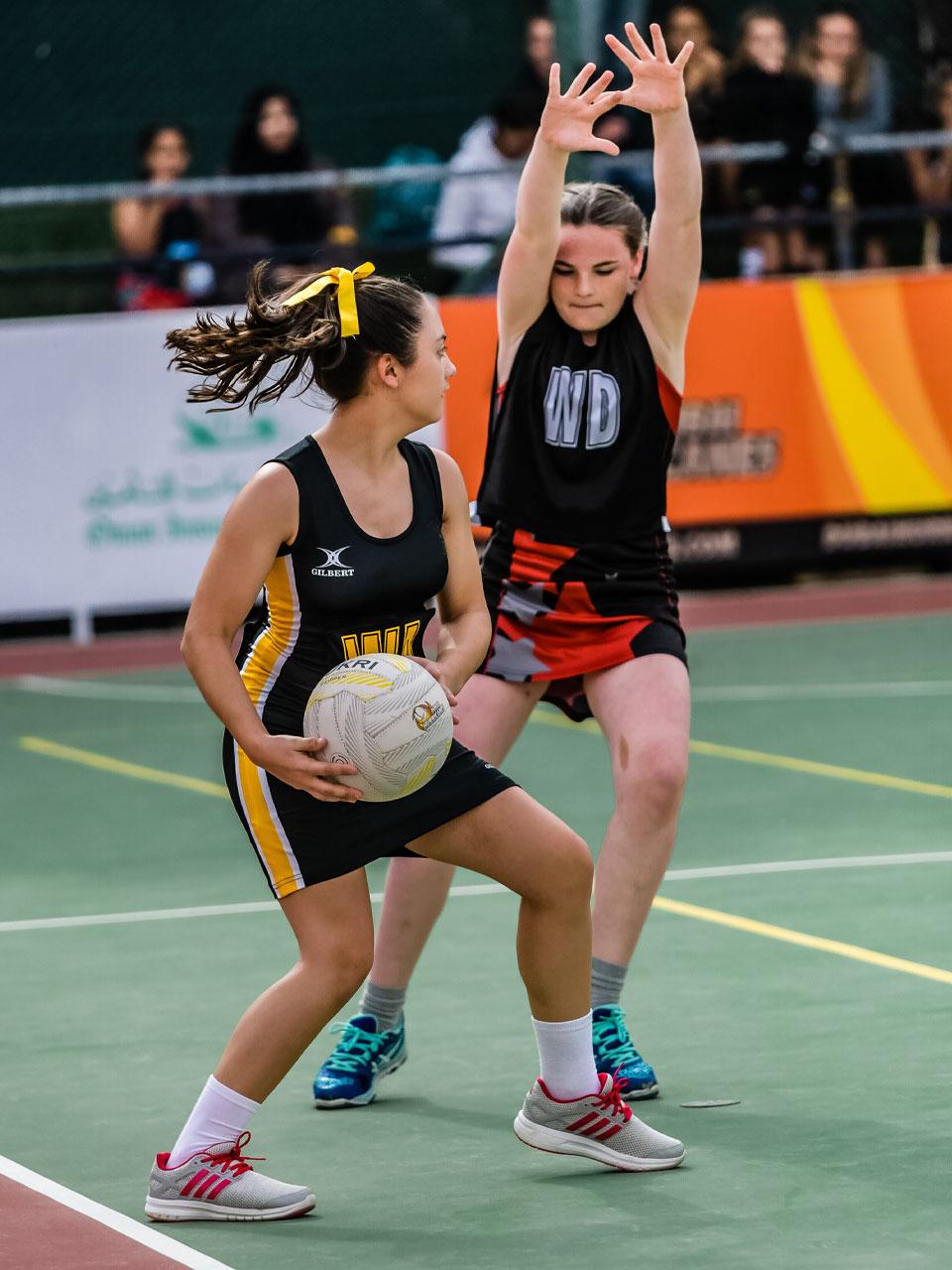 Girls playing Netball in Dubai